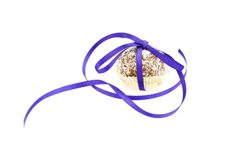 cake topped with coconut bandaged tape isolated on white photo