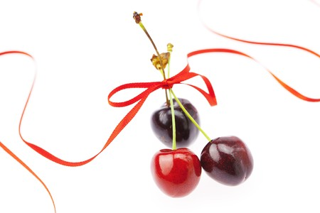 cherry with ribbon isolated on white photo