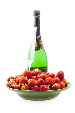Champagne glass and strawberries isolated on white photo