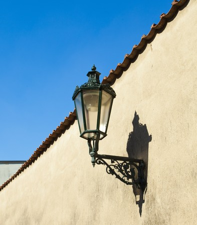 The lantern on the wall against the sky photo