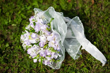 bridal bouquet lying on the grass photo