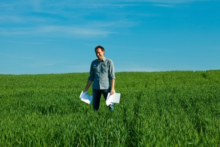 young man throwing a paper in the green field Stock Photo - 7778256