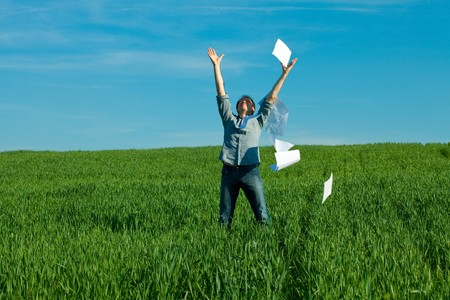 young man throwing a paper in the green field Stock Photo - 7778259