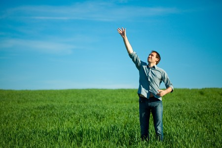 young man throwing a paper in the green field Stock Photo - 7778201