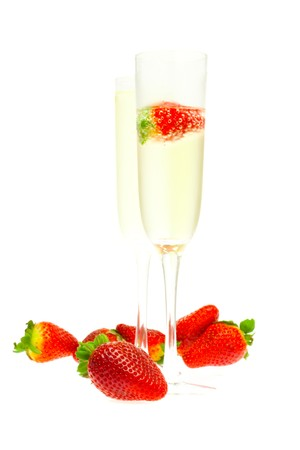 gold flute: wine glass of champagne and strawberries isolated on white Stock Photo