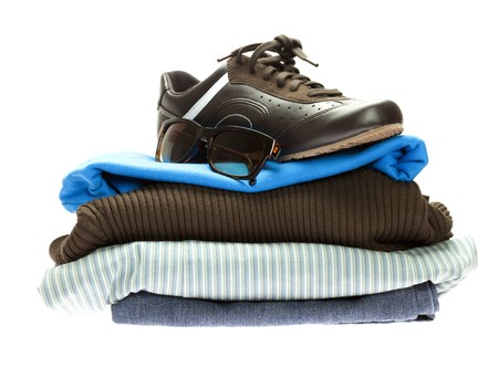 shoes and a mountain of clothes isolated on white Stock Photo