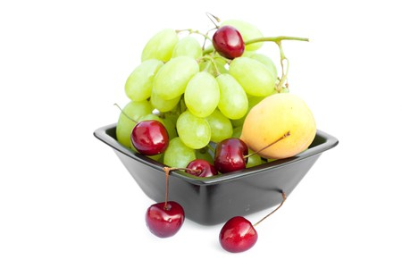 grapes cherry and apricot  in the bowl is isolated on white Stock Photo - 7778633