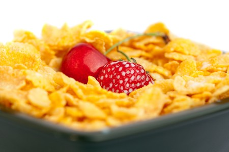 background of  bowl of cornflakes milk  cherry  and strawberry  isolated on white Stock Photo - 7778878