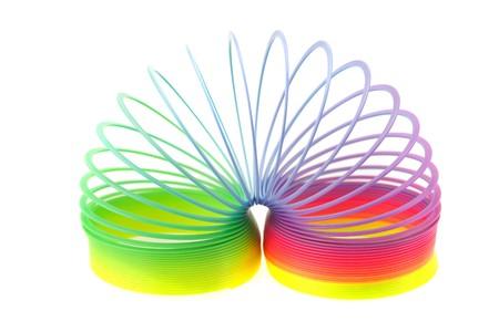 resortes: Primavera de juguete colorido aislada en blanco  Foto de archivo
