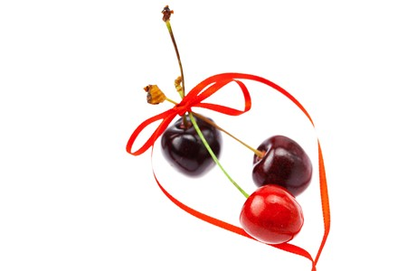 cherries tied with ribbon isolated on white photo
