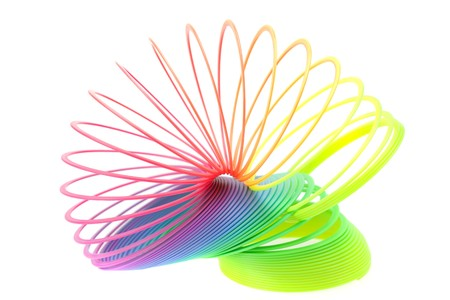 Colorful toy spring isolated on white Stock Photo