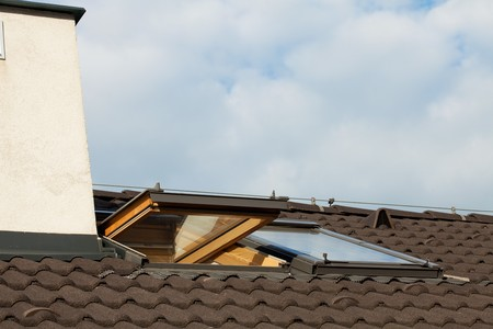 Tiled roof and dormer windows on the skyline photo