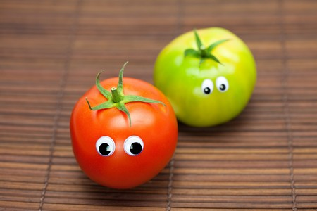 tomato with eyes on a bamboo mat photo