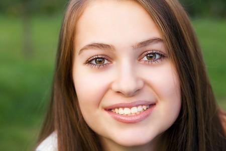 portrait of beautiful  teenager woman  outdoor photo