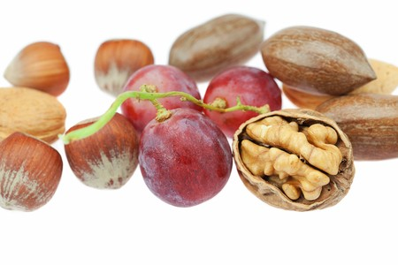 nuts and grapes isolated on white photo