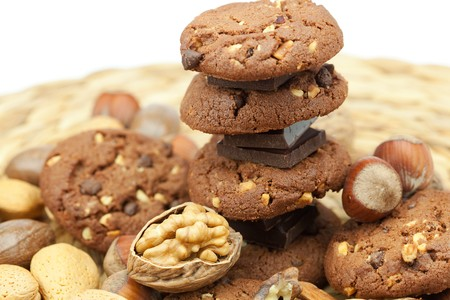oatmeal cookies, chocolate and nuts on a wicker mat Stock Photo - 8230298