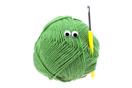 skein of wool  with eyes and crochet hooks isolated on white Stock Photo - 8230253