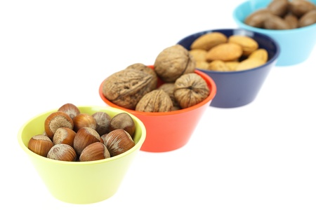 nuts in bowls isolated on white photo
