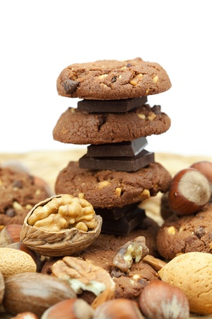 oatmeal cookies, chocolate and nuts on a wicker mat photo