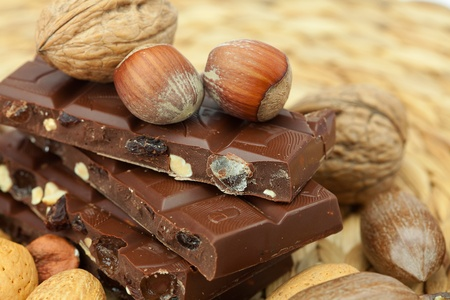 wicker bar: bar of chocolate and nuts on a wicker mat
