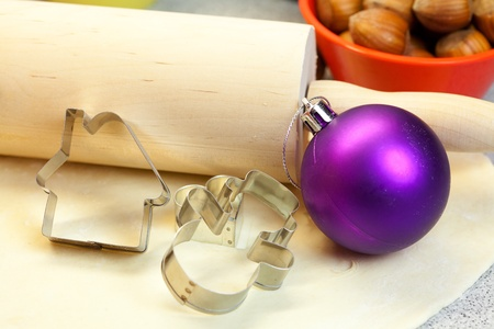 forms for the cookies, rolling pin, dough and Christmas Toy Stock Photo - 8298932