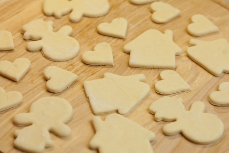 cut in the dough snowman, heart, and  house Stock Photo - 8298928