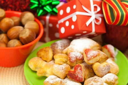 Dish, cookies, nuts, apple, bows, boxes, gifts, Christmas balls photo