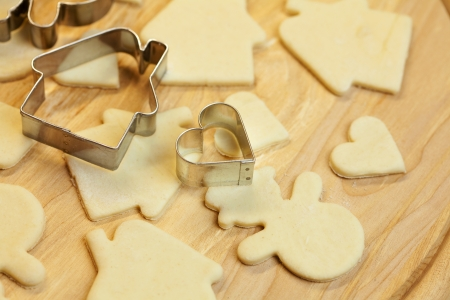 cut dough snowman, house, heart, and forms for cookies