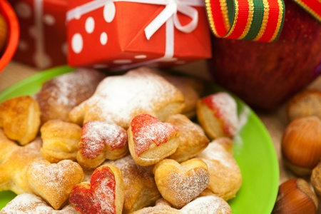 Dish, cookies, nuts, apple, bows, boxes, gifts, Christmas balls Stock Photo - 8299039