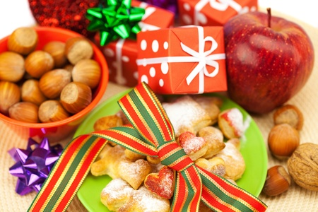 Dish, cookies, nuts, apple, bows, boxes, gifts, Christmas balls Stock Photo - 8299061