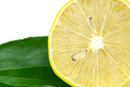 lemon with green leaf isolated on white photo