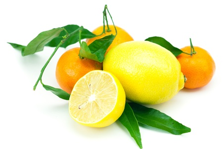 lemon and mandarin with green leaves isolated on white photo