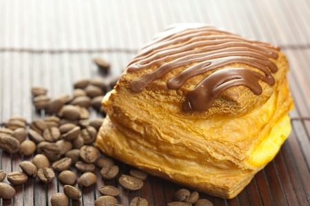 cake with chocolate and coffee beans lying on a bamboo mat photo