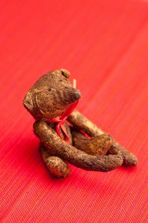 Teddy bear  handmade on a red background photo