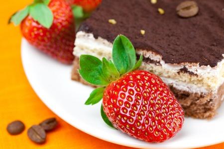 cake and strawberries lying on the orange fabric Stock Photo - 8672153