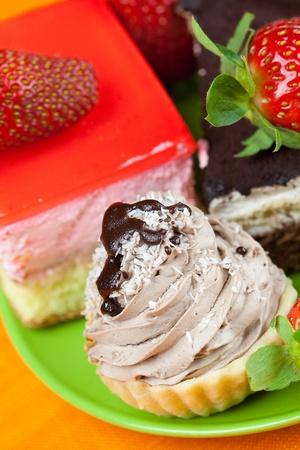 cake and strawberries lying on the orange fabric photo