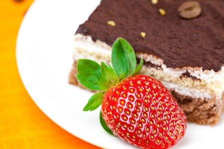 cake and strawberries lying on the orange fabric Stock Photo - 8721584