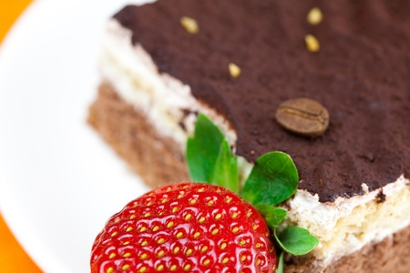 cake on a plate and strawberries lying on the orange fabric Stock Photo - 8721576