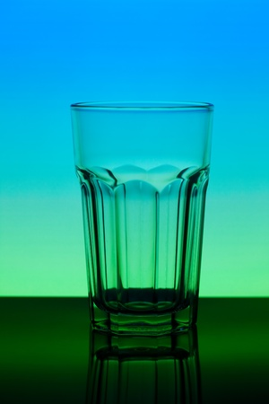 conceptually: a conceptually illuminated glasses on gradient background