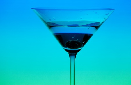 conceptually: conceptually illuminated martini glass on gradient background Stock Photo
