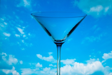 conceptually: conceptually illuminated martini glass against the sky Stock Photo