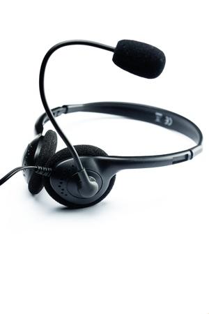 telephone headsets: es aislado un auricular negro sobre blanco