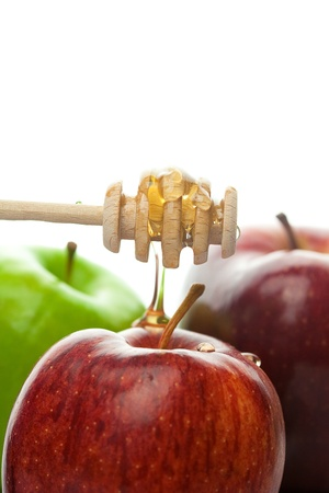 honey apple: stick to honey and apples isolated on white Stock Photo