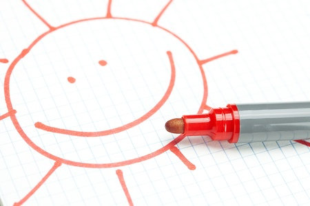 marker and painted the sun on the notebook sheet photo