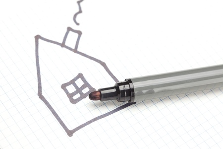 marker and painted the house on the notebook sheet photo