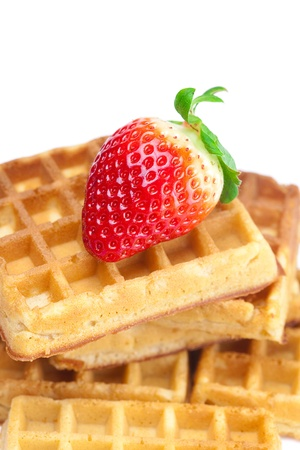 big juicy ripe strawberries and waffles isolated on white Stock Photo - 9084473