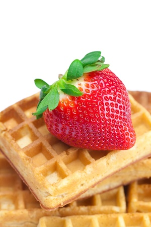 big juicy ripe strawberries and waffles isolated on white photo