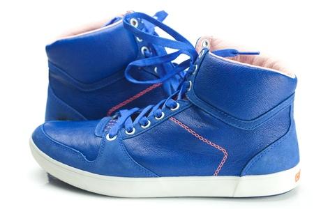 beautiful blue athletic shoes isolated on white photo