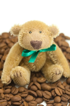 teddy bear with a bow and coffee beans  Stock Photo - 9185707