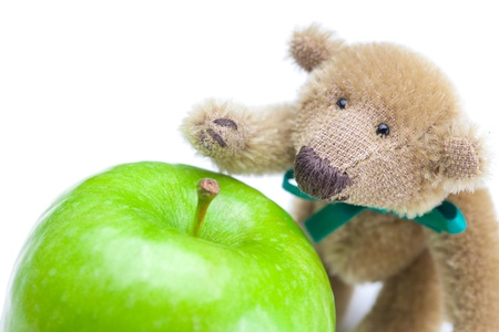 teddy bear and  apple  isolated on white photo